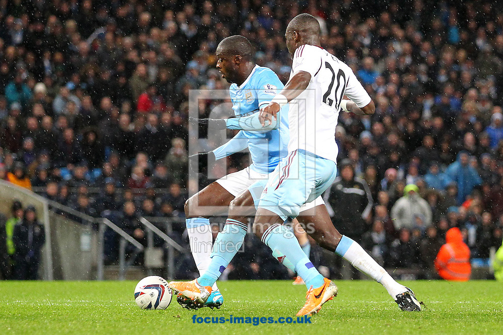 Picture by Paul Chesterton/Focus Images Ltd +44 7904 640267<br /> 08/01/2014<br /> Yaya Tour&eacute; of Man City on a run with the ball from the halfway line that ends up with him scoring his side's 3rd goal during the Capital One Cup Semi Final 1st Leg match at the Etihad Stadium, Manchester.