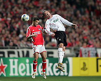 Photo: Lee Earle.<br /> Benfica v Liverpool. UEFA Champions League. 2nd Round, 1st Leg. 21/02/2006. Liverpool's Harry Kewell (R) clashes with Simao.