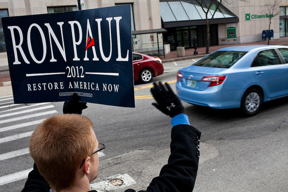 Jeremy Stull, a senior at Quinnipiac University from Lehman, Pennsylvania, waves a sign in support of Republican presidential candidate Ron Paul on Sunday, January 8, 2012 in Manchester, NH. Brendan Hoffman for the New York Times