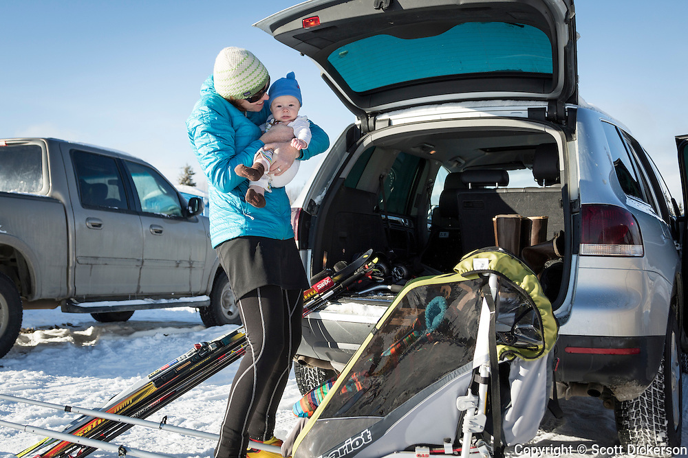 Stephanie Dickerson takes baby Riley out nordic skiing near Homer, Alaska on a sunny winter day.