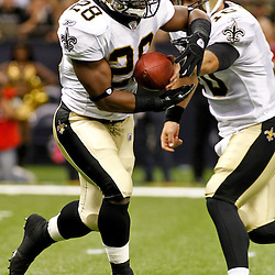 August 12, 2011; New Orleans, LA, USA; New Orleans Saints running back Mark Ingram (28) takes a hand off from quarterback Chase Daniel (10) during the first half of a preseason game against the San Francisco 49ers at the Louisiana Superdome. Mandatory Credit: Derick E. Hingle