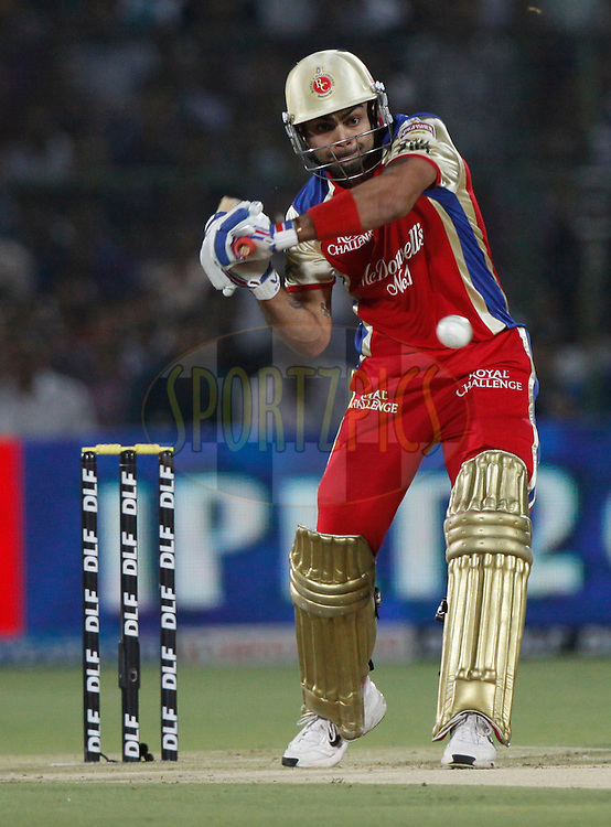 Royal Challengers Bangalore player Virat Kohli play a shot during match 30 of the the Indian Premier League ( IPL) 2012  between The Rajasthan Royals and the Royal Challengers Bangalore held at the Sawai Mansingh Stadium in Jaipur on the 23rd April 2012..Photo by Pankaj Nangia/IPL/SPORTZPICS