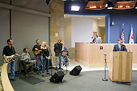 Live music is a feature of every Thursday Austin City Council meeting. Here Paul Nelson and her band perform.