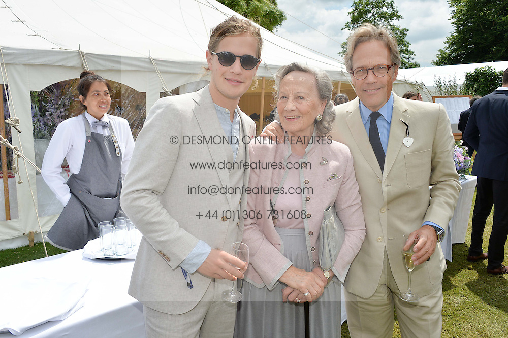 Left to right, LORD SETTRINGTON, the DUCHESS OF RICHMOND & GORDON and the EARL OF MARCH at the Cartier hosted Style et Lux at The Goodwood Festival of Speed at Goodwood House, West Sussex on 26th June 2016.