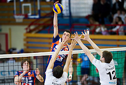 Milan Rasic of ACH vs Domen Kotnik and Jernej Stavbar of Calcit during volleyball match between Calcit Volleyball and ACH Volley in 4th Final Round of Radenska Classic League 2012/13 on April 16, 2013 in Arena Kamnik, Slovenia. (Photo By Vid Ponikvar / Sportida)