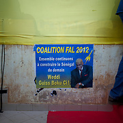 February 22, 2012 - Dakar, Senegal: A campaign poster of the president Abdoulaye Wade is displayed in a wall during a campaign rally in Pykine, a suburb of the capital Dakar, ahead of the presidential elections on the 26th of February.  (Paulo Nunes dos Santos/Polaris)