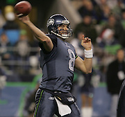 Seattle Seahawks quarterback Matt Hasselbeck(8) throws the ball under pressure from Dallas defenders at Qwest Field in Seattle Dec. 6, 2004. Photo by Kevin P. Casey/Wireimage.com