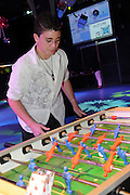 Teen plays table foosball - model release available