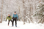 USA, Alaska, Anchorage, Two cross-country skiers enjoy the trails at the Campbell Track near the BLM Campbell Creek Science and Nature Center.