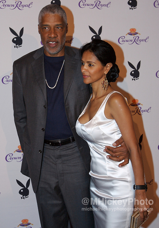 "Basketball great Julius ""Dr J"" Erving and guest at the Kentucky Derby Crown Royal Playboy party in Louisville, Kentucky on May 4 , 2007. Photo by Michael Hickey"
