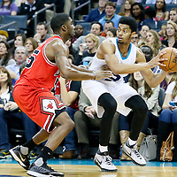 03 November 2015: Charlotte Hornets guard Jeremy Lamb (3) looks to pass the ball over Chicago Bulls guard E'Twaun Moore (55) during the Charlotte Hornets  130-105 victory over the Chicago Bulls, at the Time Warner Cable Arena, in Charlotte, North Carolina, USA.