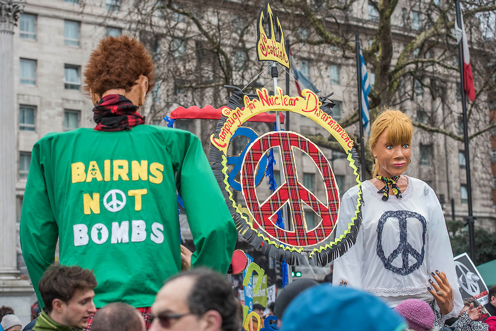 """A CND led national demonstration to protest against Britain's nuclear weapons system: Trident. They state - """"The majority of the British people, including the Labour leader Jeremy Corbyn, oppose nuclear weapons. They are weapons of mass destruction, they don't keep us safe and they divert resources from essential spending."""" The march from Hyde park to Trafalgar Square was supported by Friends of the Earth, the Green party, Greenpeace, the PCS Union, the Quakers, the Stop the War Coalition, War on Want amongst amny others."""
