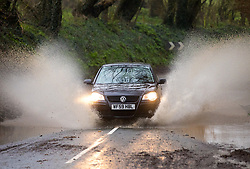© Licensed to London News Pictures. 02/04/2018. St Austell, UK. A car drives through a deep puddle near Portmellon, Cornwall. Cornwall experienced heavy rainfall overnight, causing rough seas, flooding and road closures across the county. Photo credit : Tom Nicholson/LNP