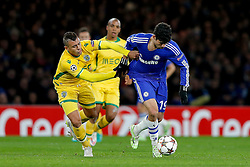 Diego Costa of Chelsea is challenged by Mauricio of Sporting - Photo mandatory by-line: Rogan Thomson/JMP - 07966 386802 - 10/12/2014 - SPORT - FOOTBALL - London, England - Stamford Bridge - Sporting Clube de Portugal - UEFA Champions League Group G.