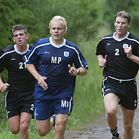 St Johnstone players back in pre-season training today, doing some tough hill running above Perth, pictured new player coach Mixu Paatelainen with Mark Ferry and Darren Dods<br />see story by Gordon Bannerman Tel: 07729 865788<br />Picture by Graeme Hart.<br />Copyright Perthshire Picture Agency<br />Tel: 01738 623350  Mobile: 07990 594431