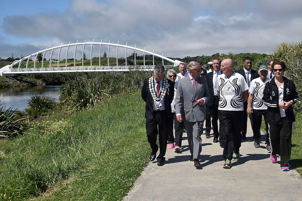 Prince Charles, Prince of Wales, centre, walks with local walking group members during a visit to the Te Rewa Rewa bridge on the coastal walkway, New Plymouth, New Zealand, New Zealand, Monday, November 09, 2015. Credit:SNPA / AFP, Marty Melville  **POOL**