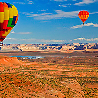 Over 60 balloons flew in the 2011 Balloon Regatta in Page, Arizona. Light winds took participants across the city of Page, and then across the famous Antelope Canyon, and toward Lake Powell in the background.