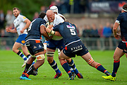 Matt Garvey, Captain of Bath Rugby is stopped by Viliame Mata of Edinburgh Rugby and Ben Toolis of Edinburgh Rugby  during the Rugby Friendly match between Edinburgh Rugby and Bath Rugby at Meggetland Sports Complex, Edinburgh, Scotland on 17 August 2018.