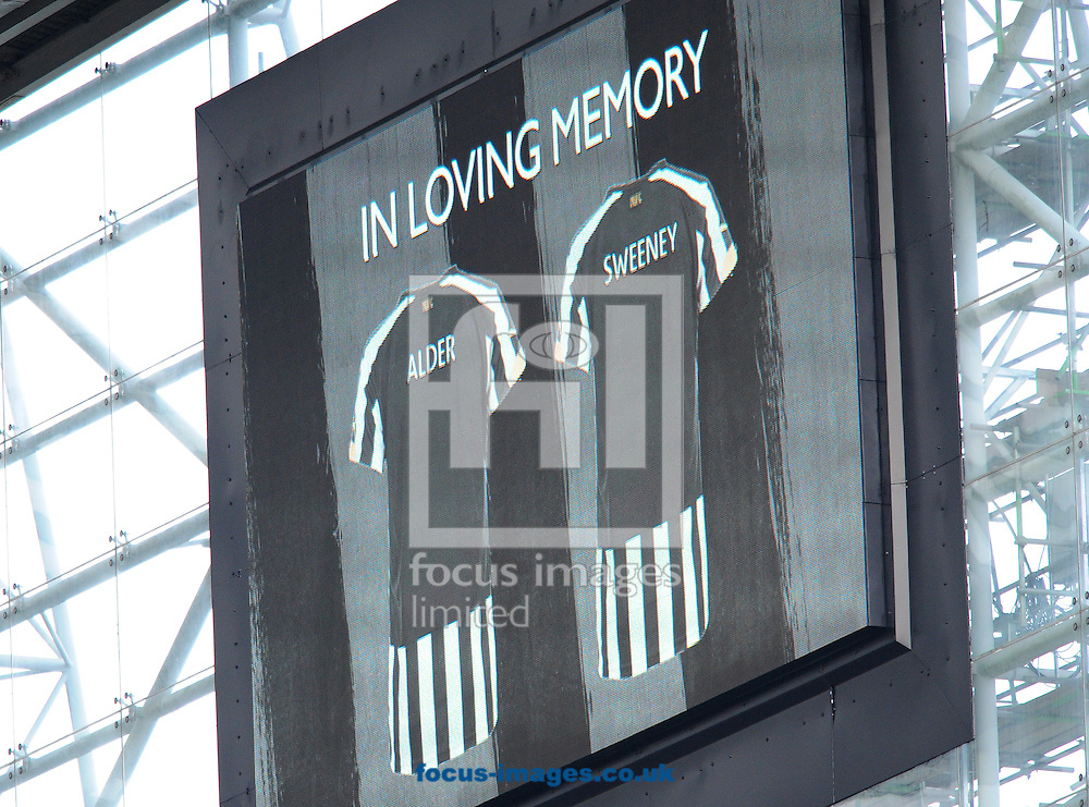 A screen with names of two Newcastle United supporters, the victims of Malaysian Airlines flight MH17 during the Barclays Premier League match at St. James's Park, Newcastle<br /> Picture by Greg Kwasnik/Focus Images Ltd +44 7902 021456<br /> 01/11/2014