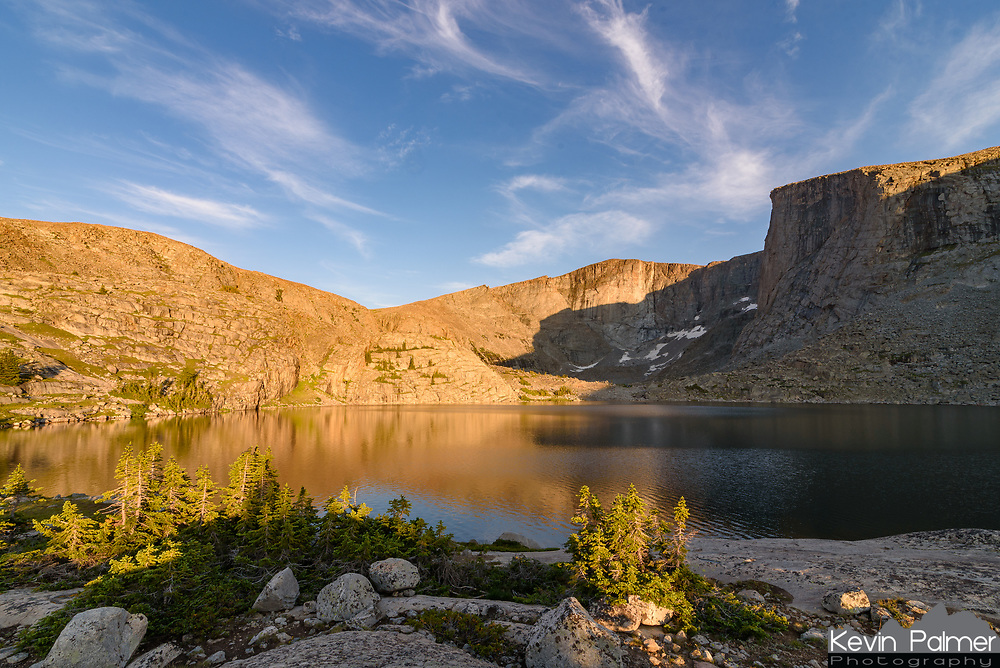 The Lost Twin Lakes are found at 10,300 feet  in the Cloud Peak Wilderness. A 6 mile hike from the West Tensleep Lake trailhead, it's the perfect spot for an overnight backpacking trip. The two lakes are in a glacial cirque surrounded by massive granite cliffs up to 2,000 feet high. Treeline in the Bighorns is at about 10,500' feet so most of the trees were very short around the lake.