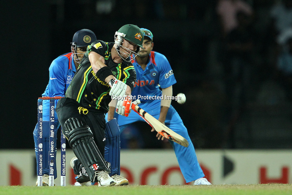 David Warner knocks Harbhajan Singh for six during the ICC World Twenty20 Super 8s match between Australia and India held at the Premadasa Stadium in Colombo, Sri Lanka on the 28th September 2012<br /> <br /> Photo by Ron Gaunt/SPORTZPICS