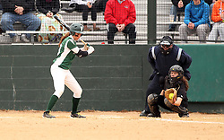 30 March 2013:  Allie Riordan during an NCAA Division III women's softball game between the DePauw Tigers and the Illinois Wesleyan Titans in Bloomington IL<br /> <br /> Umpire is Jay MacDaniels of Pekin IL