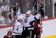 May 13, 2012; Glendale, AZ, USA; Los Angeles Kings left wing Dwight King (74) celebrates with center Mike Richards (10) after scoring a goal in the second period of game one of the Western Conference finals of the 2012 Stanley Cup Playoffs at Jobing.com Arena.  Mandatory Credit: Jennifer Stewart-US PRESSWIRE.