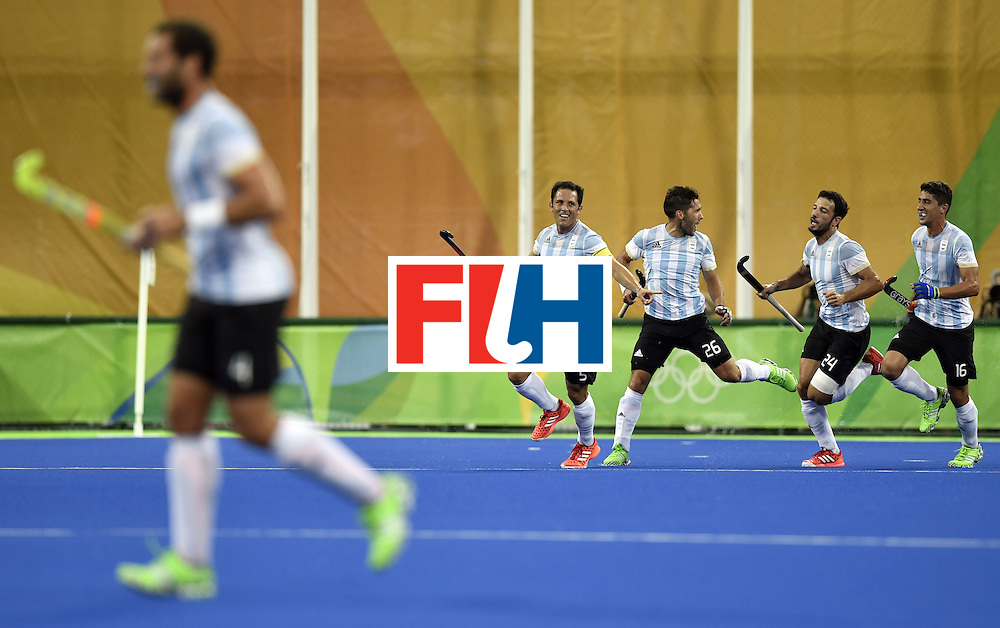 Argentina's Pedro Ibarra (4th R) celebrates a goal with teammates during the men's Gold medal field hockey Belgium vs Argentina match of the Rio 2016 Olympics Games at the Olympic Hockey Centre in Rio de Janeiro on August 18, 2016. / AFP / PHILIPPE LOPEZ        (Photo credit should read PHILIPPE LOPEZ/AFP/Getty Images)