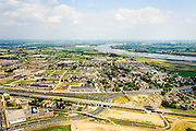 Nederland, Gelderland, Gemeente Nijmegen, 26-06-2013;  Lent, Vinex-locatie Waalsprong. Rivier de Waal in de achtergrond.<br /> New housing estate in east of the Netherlands, near Nijmegen and river Waal.<br /> luchtfoto (toeslag op standaard tarieven);<br /> aerial photo (additional fee required);<br /> copyright foto/photo Siebe Swart.