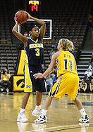 26 JANUARY 2009: Michigan guard Veronica Hicks (3) looks for someone to pass the ball to while being defended by Iowa guard Kristi Smith (11) during the second half of an NCAA women's college basketball game Monday, Jan. 26, 2009, at Carver-Hawkeye Arena in Iowa City, Iowa. Iowa defeated Michigan 77-69.