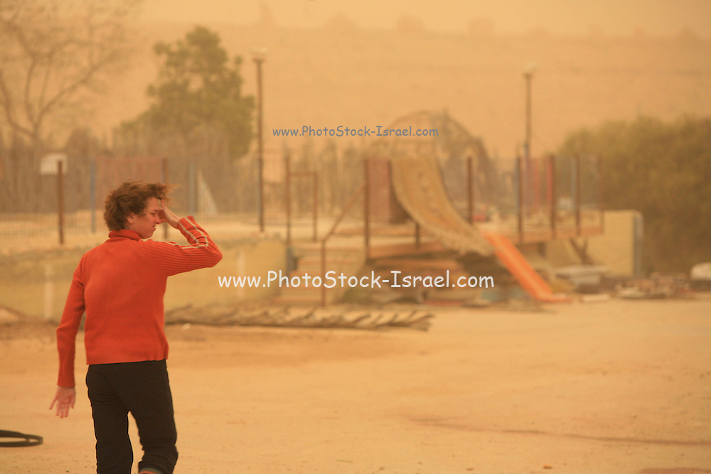 Israel, Negev, Mitzpe Ramon, A desert sand storm People run for shelter