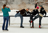 25 DEC. 2010 -- ST. LOUIS -- Annette Rose (center) is joined by her sons Nicholas Holder (left) and Ian Holder for a photograph taken by family friend Kelli Spoede (far left) during a Christmas Day skating session at the Steinberg Skating Rink in Forest Park in St. Louis Saturday, Dec. 25, 2010. The family is from South St. Louis County. Image © copyright 2010 by Sid Hastings.