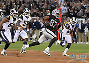 Sep 10, 2018; Oakland, CA, USA; Oakland Raiders tight end Jared Cook (87) is pursued by Los Angeles Rams linebacker Ramik Wilson (52), linebacker Cory Littleton (58) and defensive back Lamarcus Joyner (20) on a 45-yard reception in the first quarter at the Oakland-Alameda County Coliseum. The Rams defeated the Raiders 33-13.
