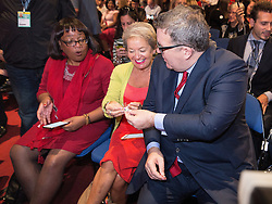 © Licensed to London News Pictures . 28/09/2016 . Liverpool , UK . TOM WATSON (r) offers Love Heart sweets to DIANE ABBOTT (l) and ROSIE WINTERTON (c) ahead of the Leader's Speech at the close of the final day of the Labour Party Conference at the ACC in Liverpool . Photo credit : Joel Goodman/LNP