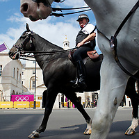Mounted police patrol Whitehall and the Horses Guard the first full day of athletics in the 2012 London Summer Olympics.