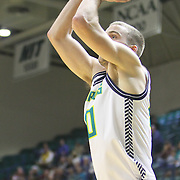 UNCW's Dylan Sherwood shoots against Liberty Wednesday December 17, 2014 at Trask Coliseum on the campus of UNCW in Wilmington, N.C. (Jason A. Frizzelle)