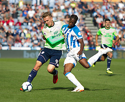 Terence Kongolo of Huddersfield Town (R) tackles Danny Ward of Cardiff City - Mandatory by-line: Jack Phillips/JMP - 25/08/2018 - FOOTBALL - The John Smith's Stadium - Huddersfield, England - Huddersfield Town v Cardiff City - English Premier League