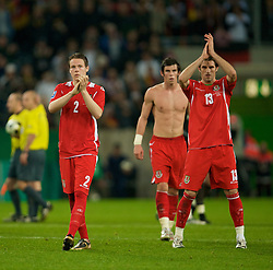 MONCHENGLADBACH, GERMANY - Wednesday, October 15, 2008: Wales' Chris Gunter, Gareth Bale and Sam Ricketts look dejected after losing 1-0 to Germany during the 2010 FIFA World Cup South Africa Qualifying Group 4 match at the Borussia-Park Stadium. (Photo by David Rawcliffe/Propaganda)