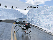 Bicycle at Crater Lake National Park in early June when Rim Drive is closed to cars to allow snow plowing, Oregon, USA.