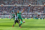 Craig Dawson (#4) of Watford clears the ball out for a corner under pressure from Christian Atsu (#30) of Newcastle United during the Premier League match between Newcastle United and Watford at St. James's Park, Newcastle, England on 31 August 2019.