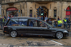 © Licensed to London News Pictures. 14/10/2019. Oxford, UK. A hearse containing the coffin of Thames Valley Police officer PC Andrew Harper makes its way to Christ Church Cathedral in Oxford city centre. Photo credit: Peter Manning/LNP