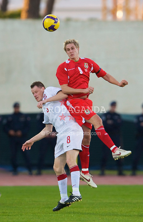 VILA REAL DE SANTO ANTONIO, PORTUGAL - Wednesday, February 11, 2009: Wales' David Edwards in action against Poland's Jacek Krzynowek during the International Friendly match at the Vila Real de Santo Antonio Sports Complex. (Mandatory credit: David Rawcliffe/Propaganda)