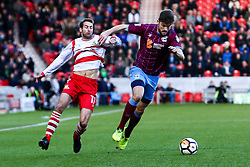 Josh Morris of Scunthorpe United holds off Matty Blair of Doncaster Rovers - Mandatory by-line: Ryan Crockett/JMP - 03/12/2017 - FOOTBALL - The Keepmoat Stadium - Doncaster, England - Doncaster Rovers v Scunthorpe United - Emirates FA Cup second round