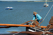 """Bairbre de Buitléir  ties up  """"Star of the West"""" at  the pier at Parkmore during  the Crinniu na mBad (Gathering of the boats) Festival  in Kinvara Co. Galway at the weekend featuring Galway hookers racing across the bay. Photo:Andrew Downes."""