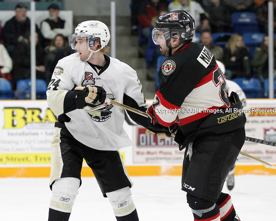 TRENTON, - Mar 1, 2016 -  Ontario Junior Hockey League game action between the Trenton Golden Hawks and the Newmarket Hurricanes. Game 1 of the first round playoff series at the Duncan Memorial Gardens, ON, Jordan Dasilva #24 of the Trenton Golden Hawks and Stephen Mariani #27 of the Newmarket Hurricanes during the second period<br />  (Photo by Amy Deroche / OJHL Images)