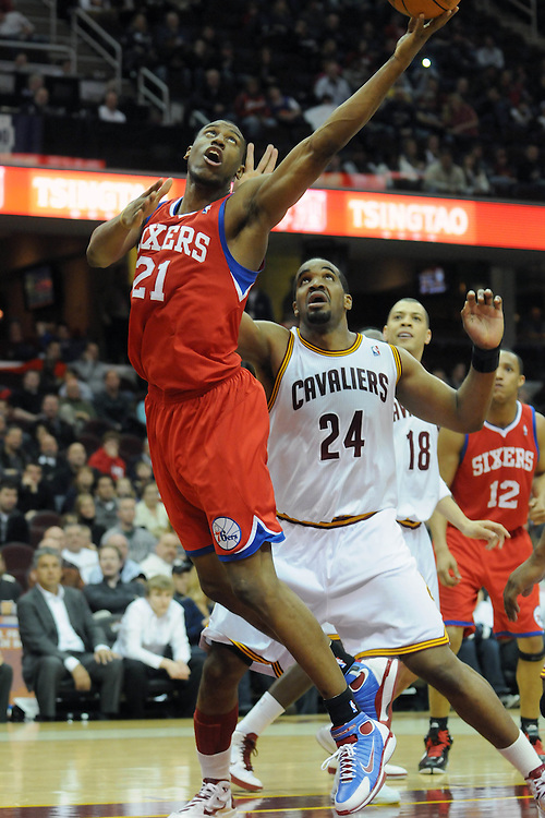 Feb. 27, 2011; Cleveland, OH, USA; Philadelphia 76ers forward Thaddeus Young (21) puts in a layup over Cleveland Cavaliers power forward Samardo Samuels (24) during the fourth quarter at Quicken Loans Arena. The 76ers beat the Cavaliers 95-91.Mandatory Credit: Jason Miller-US PRESSWIRE