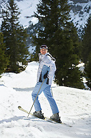Female skier standing on ski slope