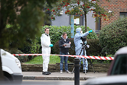 © Licensed to London News Pictures. 15/10/2015. London, UK.  Police forensics at The scene on Scriven Street in Hackney, east London where a male police officer was shot during an authorised firearms operation by the Trident gang crime unit of the Metropolitian Police.  A man has been arrested at the scene. Photo credit: Peter Macdiarmid/LNP