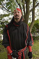 Garden City, New York, U.S. - June 14, 2014 - DRAYDEN LAYTH, from Staten Island, is wearing an Amgard outfit for combat sport, at Eternal Con, the annual Pop Culture Expo, with costumes, Comic Books, Collectibles, Gaming, Sci-Fi, Cosplay, Horror, and held at the Cradle of Aviation Museum on Long Island.
