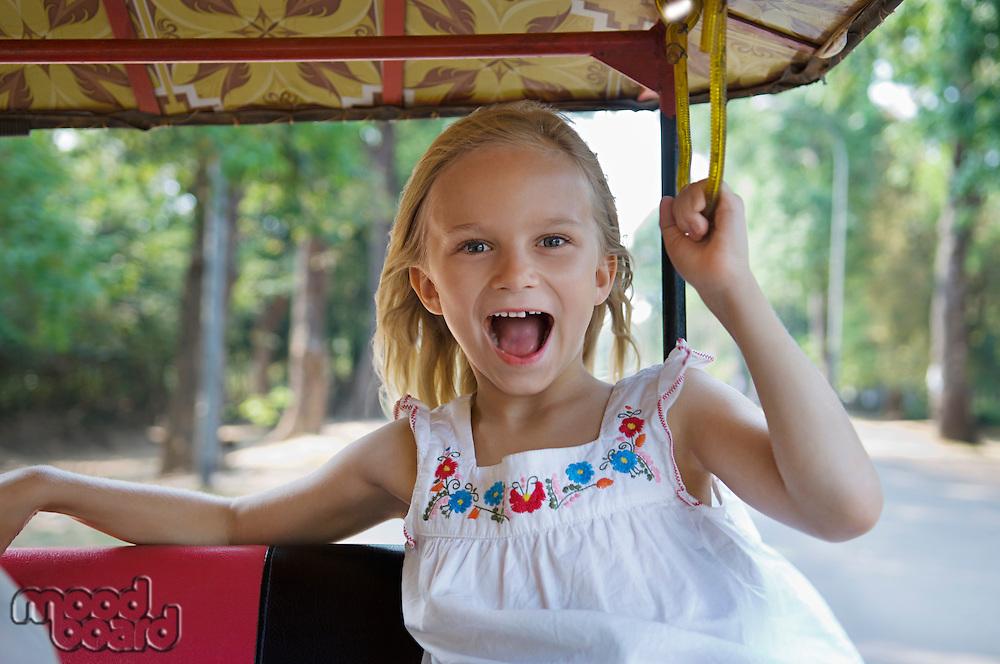 Little Girl Riding in Rickshaw